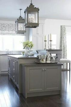 split-level island - an option for getting an eat-in counter on our island :: cabinet color, gray kitchen,