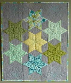Janet's - love how more hexies are created in the quilting.