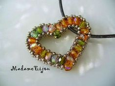 Lovely beaded Heart Pendant made with seed and Fire Polish beads by Madame Bijou.