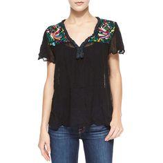 "Golden by Jen Rossi.  Belen Short-Sleeve Paradise-Embroidered Blouse, Black.  Golden by Jen Rossi ""Belen"" blouse with paradise embroidery.  Braided V neckline.…"
