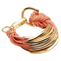 Multi-strand bracelet in coral with metal hardware on cotton cord with lobster clasp.   Product: BraceletConstructio...