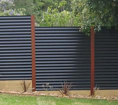 Corrugated metal privacy fence                                                                                                                                                      More