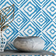 We love this pattern because the blue color is refreshing and uplifting, while the watercolor effect is soft and a little quirky. This is perfect if you want a touch of the unusual, while sticking to some classic design elements. The pattern would look lovely in an entryway, hallway, bathroom, or bedroom. >>HOW TO APPLY<< Leo and Emily include easy application instructions with your order. Simply wipe clean your surface, peel off the top portion of the wallpaper backing, and appl...