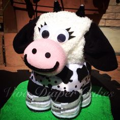 Cow diaper cake . FULLY DISASSEMBLES into useable and UNDAMAGED baby items, plus a pair of ladies socks for the mom to be . Order through our Facebook page or website. Www.vivadiapercakes.com or www.facebook.com/vivadiapercakes . Shipping available to CAN and USA.