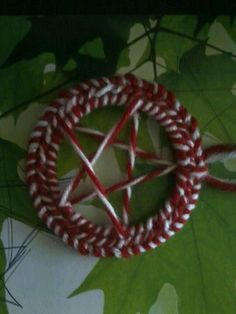 Candy cane Yule pentacle ornament.