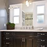 Charcoal gray with espresso cabinets.