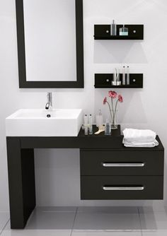 small but beautiful white bathroom with black modern vanity, flowers. Tiny Bathroom, Big Ideas: 5 Space Saving Ideas for Small Bathrooms by Tradewinds I. Bathroom Sink Cabinets, Bathroom Sink Vanity, Bathroom Furniture, Sink Countertop, Bathroom Storage, Cabinet Storage, Modern Furniture, Remodel Bathroom, Outdoor Furniture