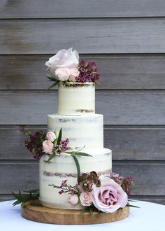 Semi-naked blush and burgundy wedding cake. www.cakesbyyolk.com