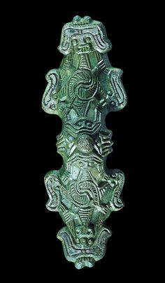 Rare Viking Equal-Arm Brooch, 10th Century ADA bronze bow brooch with hollow conical bow and symmetrical arms; the bow with central stud and facing masks above hatched bodies extending to the arms,...