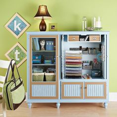 Scrapbooking Storage Center - Scrapbook in style with this super organized home scrapbooking center. The left side holds magazines and idea books in baskets as well as storage shelves for past scrapbooks or current projects. The right side is a mini crafts cabinet with stacking shelves to organize colored paper and bins for other supplies.