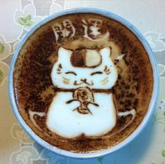 That is almost to pretty to drink! #LuckyCat #Coffee #Art
