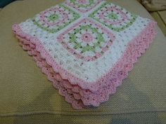 Granny squares baby blanket.   Like the color scheme