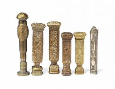 FOUR FRENCH BRASS SEAL CASES WITH INTERCHANGEABLE MATRICES <br />LATE 19TH CENTURY <br />Each case with embossed classical decoration fitted with assorted brass seal matrices<br />tallest 3 in. (7.6 cm.) <br />Together with a plated seal case lacking end and a seal converted from a brass bullet applied with an armorail of the English Royal Arms  (6)<br />