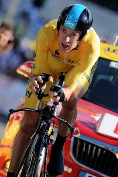 Yellow jersey holder Bradley Wiggins (Sky) won the stage 9 time trial in Besançon and extended his general classification lead.  Photo: © AFP