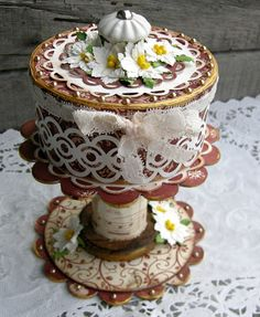 Have some candle pedestals that would work for a mini cake stand.  No Tutorial but this is altered