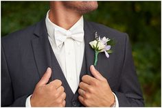 The groom straightening up his tuxedo at Medina Country Club Wedding