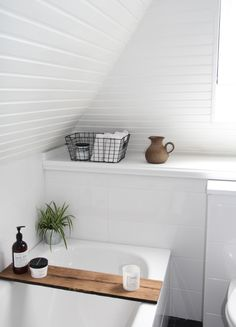 HOMEZ our new bathroom: i like the combination of cold elements like white walls and grey floor with warm elements like wood and plants