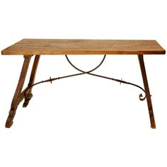 Spanish Walnut and Iron Trestle Table | From a unique collection of antique and modern farm tables at https://www.1stdibs.com/furniture/tables/farm-tables/