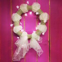 We put together this DIY Christmas Wreath using an organza sheet, gold mesh vase wrap and star-shaped string lights.