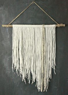DIY yarn wall hanging. This is so easy to make, you might want to involve your kids....or not:)   Twelveonmain.com