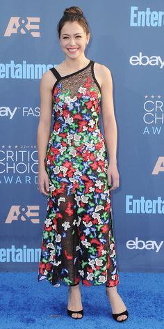 The 22nd Annual Critics' Choice Awards was a night packed with fashion winners (see all of the looks here), but we're completely enamored with Tatiana Maslany's standout look: a floral camouflage organza plisse lace dress from Boss—a dress that's both sexy and badass, just like Sarah Manning (and all her other personalities) on Orphan Black. Forevermark diamonds and black open-toe heels completed her look.  Shop similar sandals: Sam Edelman, $120; shopbop.com. DVF, $298; shopbop.com. Jimmy…