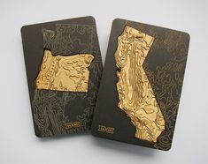 54-40 - A set of magnetic-backed US states made out of laser cut wood that show the topography of America.