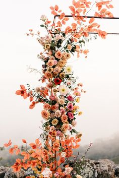 The most colorful spring, floral wedding ceremony at Oakridge Farmhouse in Southern California - 100 Layer Cake