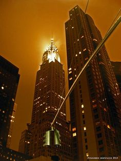 The Chrysler building by night.  The Chrysler building is an art deco skyscraper in NYC, located on the east side of Manhattan at the intersection of 42nd street and Lexington avenue. Standing at 319 metres it was the world's tallest building for 11 months before it was surpassed by the Empire State building in 1931. It is considered by many contemporary architects to be one of the finest buildings in NYC.   It was designed by architect William van Alen for a project of Walter P. Chrysler.