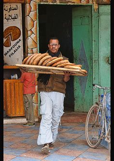 Fresh bread from the bakery in Rissani, Morocco - Maroc Désert Expérience tours http://www.marocdesertexperience.com