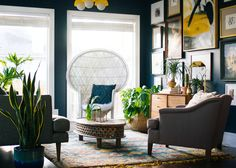navy study with picture wall and wicker chair