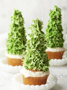 Christmas Tree Cupcakes : Decoration Ideas. Pointy ice cream cones provide the lift in these sky-high cupcakes. A star-tip frosting tool helps create the fir effect.