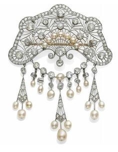 A BELLE EPOQUE DIAMOND, PEARL, PLATINUM AND GOLD BROOCH. circa 1910