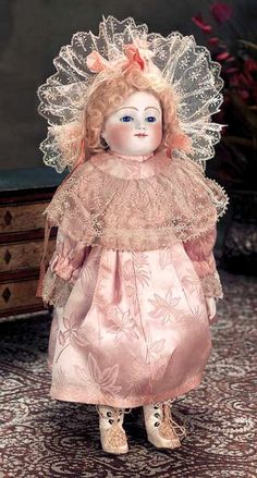 Jules Nicholas Steiner (1832-1902) —  15'' Bisque Bebe  in Antique Rose Silk Costume with Alencon Lace Collar, Matching Alencon Lace Bonnet, Cream   Boots with Silk Rosettes, c.1870   (456x850)