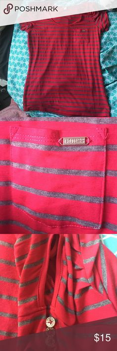 Guess pink and gray shirt Pink and gray Guess short sleeve shirt. The material is super soft and comfy. Cute opening/decorative buttons detail on the side of the sleeves (see image) pocket in the front. Guess Tops Blouses