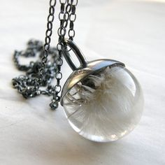 Totally amazing dandelion seed pendant by polish artist Sylwia Calus