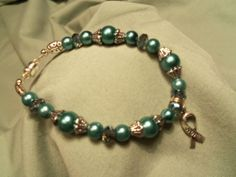 Ovarian Cancer awareness Teal glass pearl and  Crystal bracelet