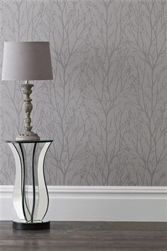 If you're styling a silver/grey bedroom, this 'Pewter Twigs' wallpaper from the Next UK online shop would be perfect. Hallway Wallpaper, Silver Wallpaper, Wallpaper Decor, Striped Wallpaper, Grey Wallpaper Ideas For Bedroom, Grey Wallpaper Living Room Uk, Grey Wallpaper With Trees, Emoji Wallpaper, Tree Wallpaper