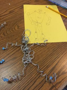 Wire person with drawing (this was done all by a young boy with special needs) we broke down how to draw a person, which he did a great job. Next we made the wire person using very soft flexible wire.