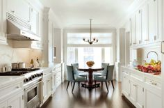#Kitchen White kitchen with a great pop with the kitchen table and chairs