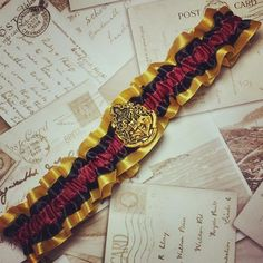 Gryffindor Garter - perfect Harry Potter inspired wedding accessory. Click on the image to see the full gallery on Harry Potter Themed Wedding.
