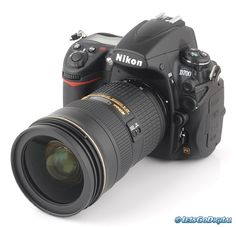 Nikon D700 with 24-70mm f/2.8 Nikkor lens. I would love to get this lense!