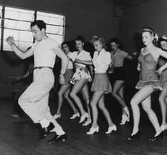 Gene Kelly leading a rehersal for DUBARRY WAS A LADY (1943) on the MGM lot.