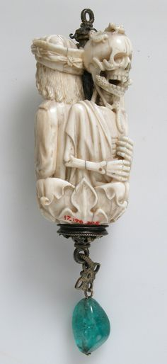 wilburwhateley:  Rosary Terminal Bead with Lovers on one side and Death's Head on the other. Netherlands ca. 1500-1525.