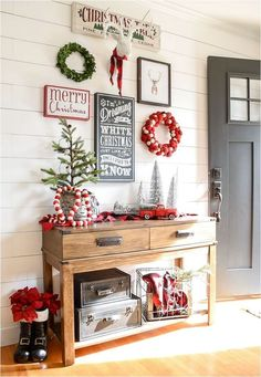 A beautiful and classic Christmas entryway and living room featuring shades of red, green and black. : A beautiful and classic Christmas entryway and living room featuring shades of red, green and black.