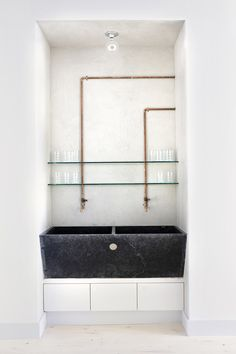 trough sink with exposed copper pipes