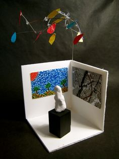 Mini museum display - bust of artist and reproductions of works