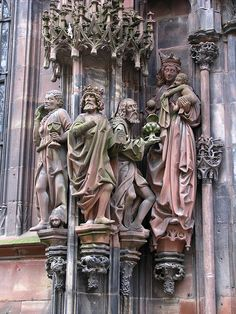 Sculptures: The three Wise Men, The Virgin Mary and the baby Jesus, cathedral of Strasbourg, Paris, France