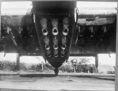 View of open fuselage bomb bay and wing bomb cells of a Handley Page Halifax Mark II 'NF-V'', of No. 138 (Special Duties) Squadron RAF at Tempsford, showing a full load of fifteen 500-lb GP bombs, prepared for the second '1,000 Bomber' raid on Essen. Although 138 Squadron was a Special Duties Squadron at the time, it was nevertheless one of the many extra units called upon to provide aircraft for the raids.
