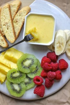 """A sweet orange """"fondue"""" for dipping cookies and fruit makes a great Super Bowl party dessert.  #biscotti  #orangefondue  #fruit"""