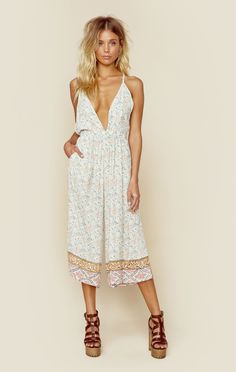 """Faithfull The Brand's Hamptons Jumpsuit features a pretty pastel print throughout, deep V neckline, wide midi length leg, and low back with criss cross straps. ImportedDry Clean Only100% RayonFit Guide:Model is 5ft 7 inches; Bust: 32"""", Waist: 24"""", Hips: 34""""Model is wearing a size XSRelaxed FitShoes Featured Not Available For Purchase"""